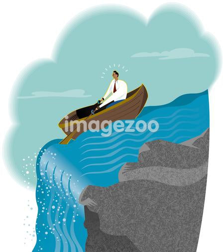 A businessman at the edge of a waterfall