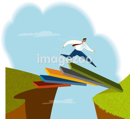 A man jumping over a chasm