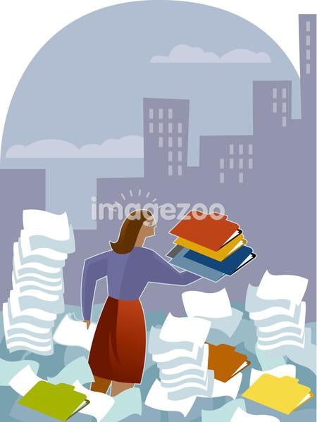 A woman amid stacks of file folders and paper