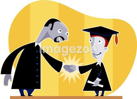A new graduate shaking hands with the principal