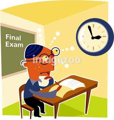 A bespectacled boy taking a final exam