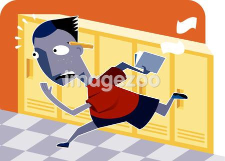 A boy running in the school hallways