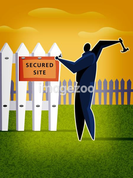 A man putting up a secured site sign