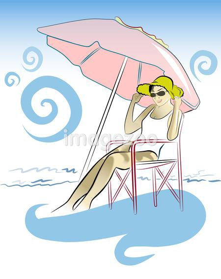 woman sitting under a beach umbrella