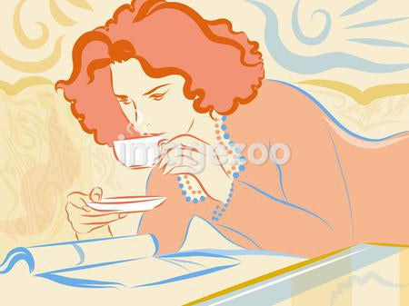 A woman having a cup of tea while reading