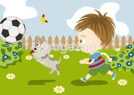 A boy playing soccer with his dog