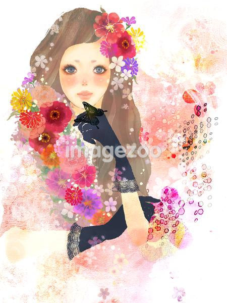 Young woman surrounded by flowers