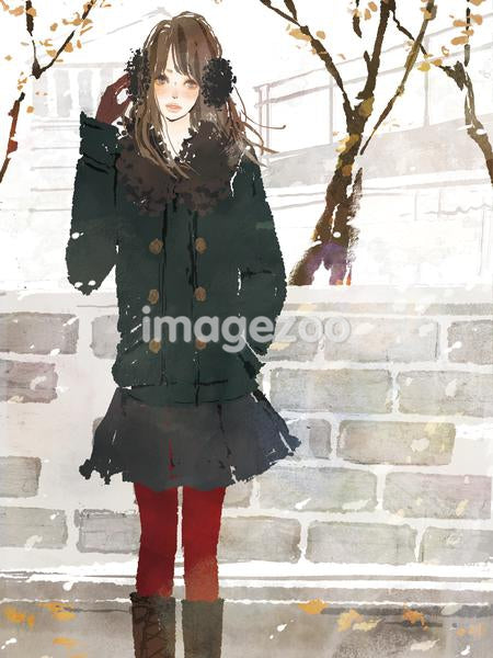 Young woman standing in snowing park