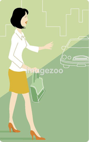 Businesswoman signaling for a taxi
