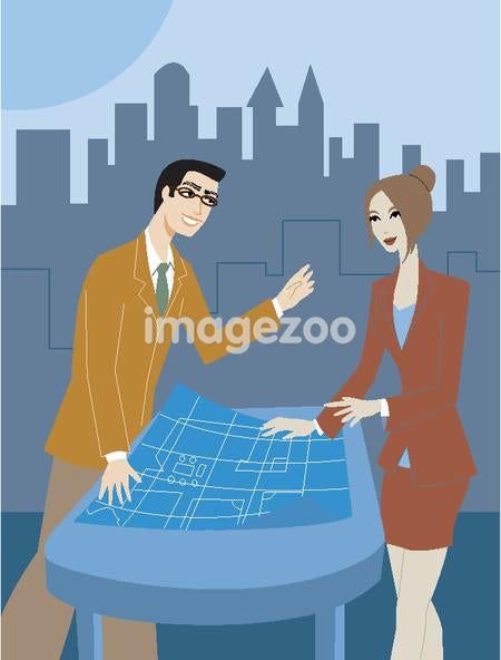 A pair of businessman and businesswoman discussing blueprints