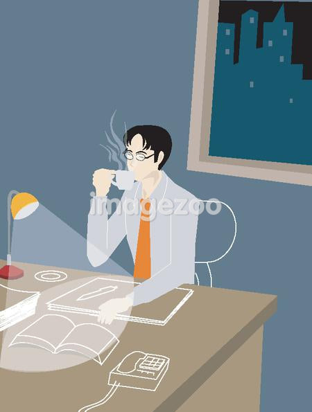 Businessman working late into the night and drinking coffee