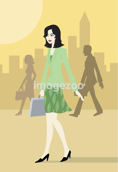 Businesswoman with briefcase walking in the city