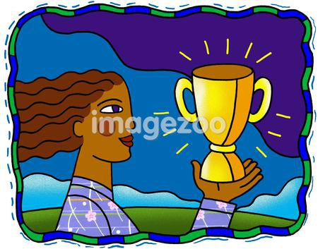 woman holding up a trophy