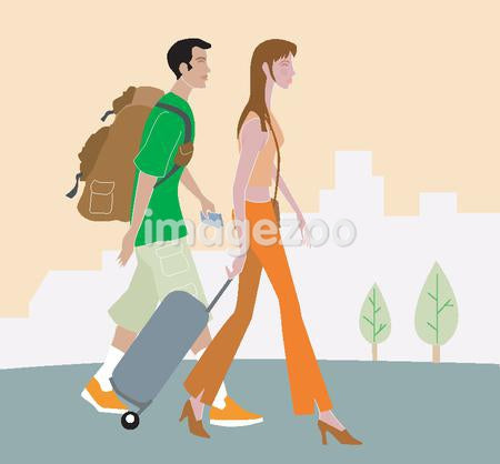 Man and woman walking with luggage