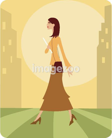 Woman walking to work in the city