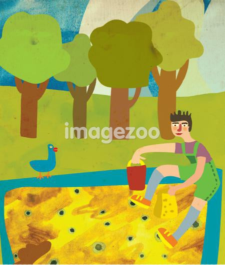 A boy playing in a sand box