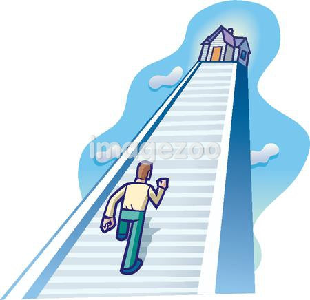 A man walking up a long flight of stairs to a house