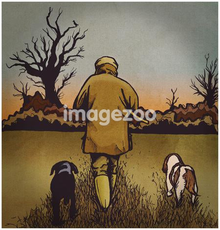 A man walking in a park with his two dogs
