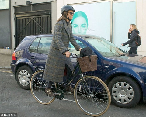 Pippa younger sister of Kate Middleton bikes through London