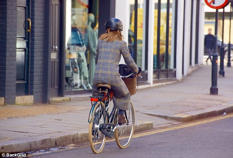 Pippa Middleton cycling away with Sawako black helmet