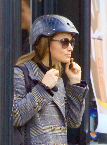 safety-conscious Pippa Middleton making sure wearing a stylish helmet