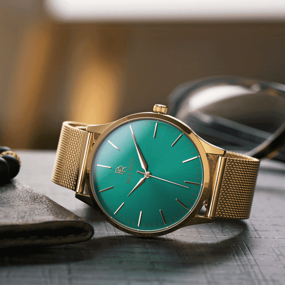 Gold watch with green dial