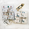 The MoMeMans® Reggie Holidays Gift Wrap by Monica Escobar Allen