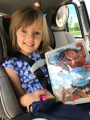 Smiling Ilana Loves Her New Moana Tin from the Growing Hero Travel Kit