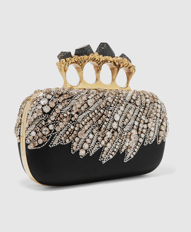 Knuckle embellished satin clutch