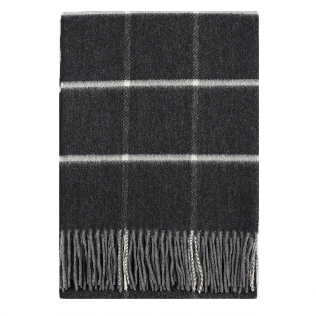 Superfine Merino is woven with a bold stripe design and has a luxurious feel. Woven at the Bute Fabrics mill on the Isle of Bute, this scarf is the perfect lightweight accessory.