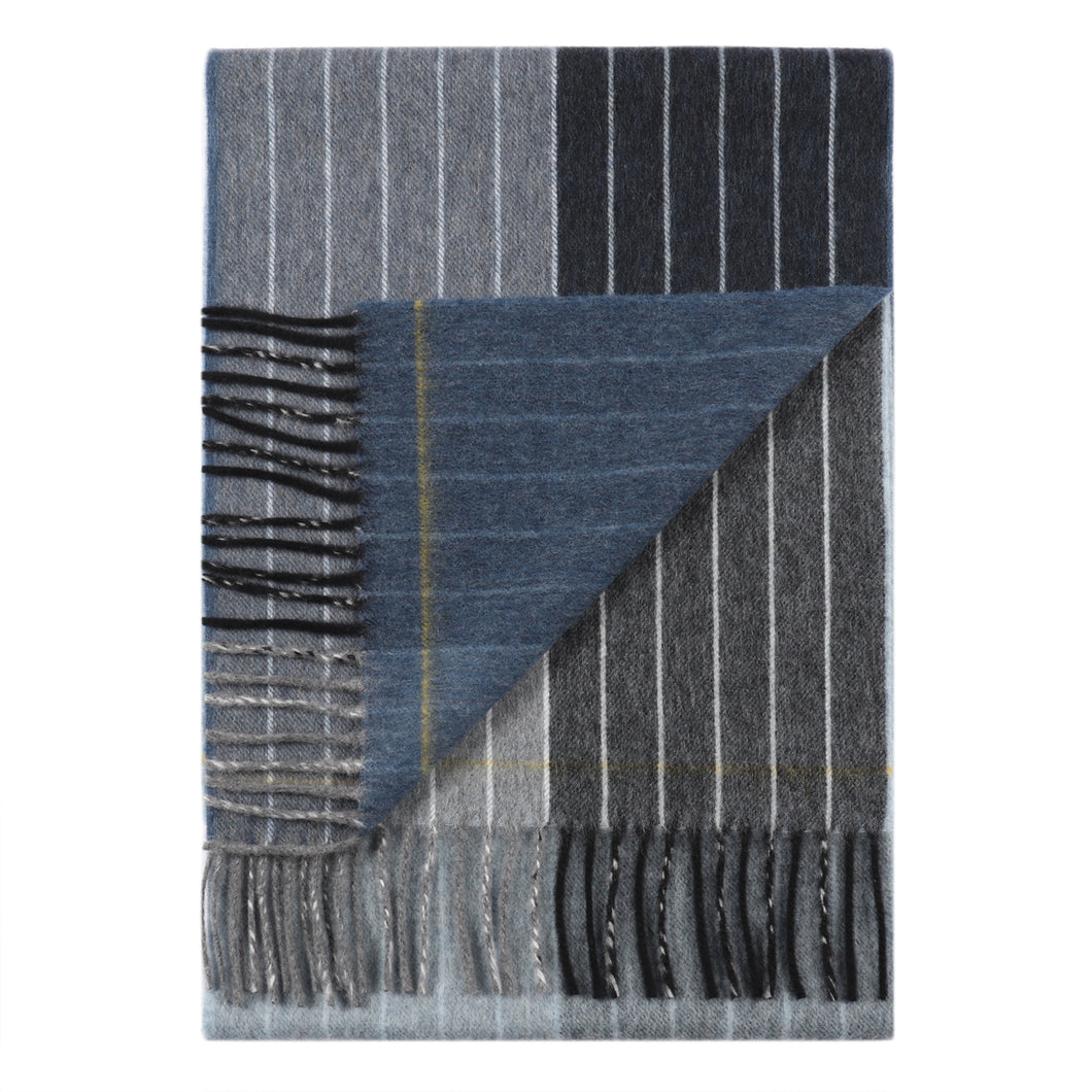 Superfine Merino is woven with a contemporary pinstripe design and has a luxurious feel. Woven at the Bute Fabrics mill on the Isle of Bute, this scarf is the perfect lightweight accessory.