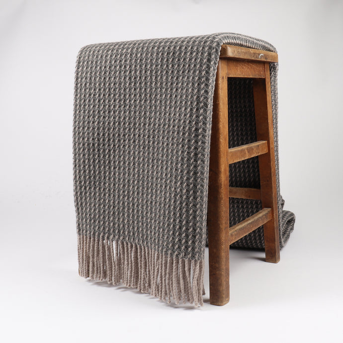 Braemar has a chunky honeycomb design, giving it a contemporary texture ideal for a modern home. Woven at the Bute Fabrics mill on the Isle of Bute, the woven pure wool is warm and breathable for a soft home comfort.