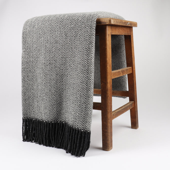 Lewis is woven with 100% wool and is the perfect addition to any interior with a classic large-scale chevron. Woven at the Bute Fabrics mill on the Isle of Bute, this soft throw is a cosy accessory with a neutral palette.