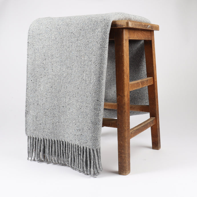 Lomond has a classic Donegal yarn characteristic complimented by a twill design. Woven with 100% Merino Wool at the Bute Fabrics mill, this throw has a luxurious handle making it ideal for a cosy interior.