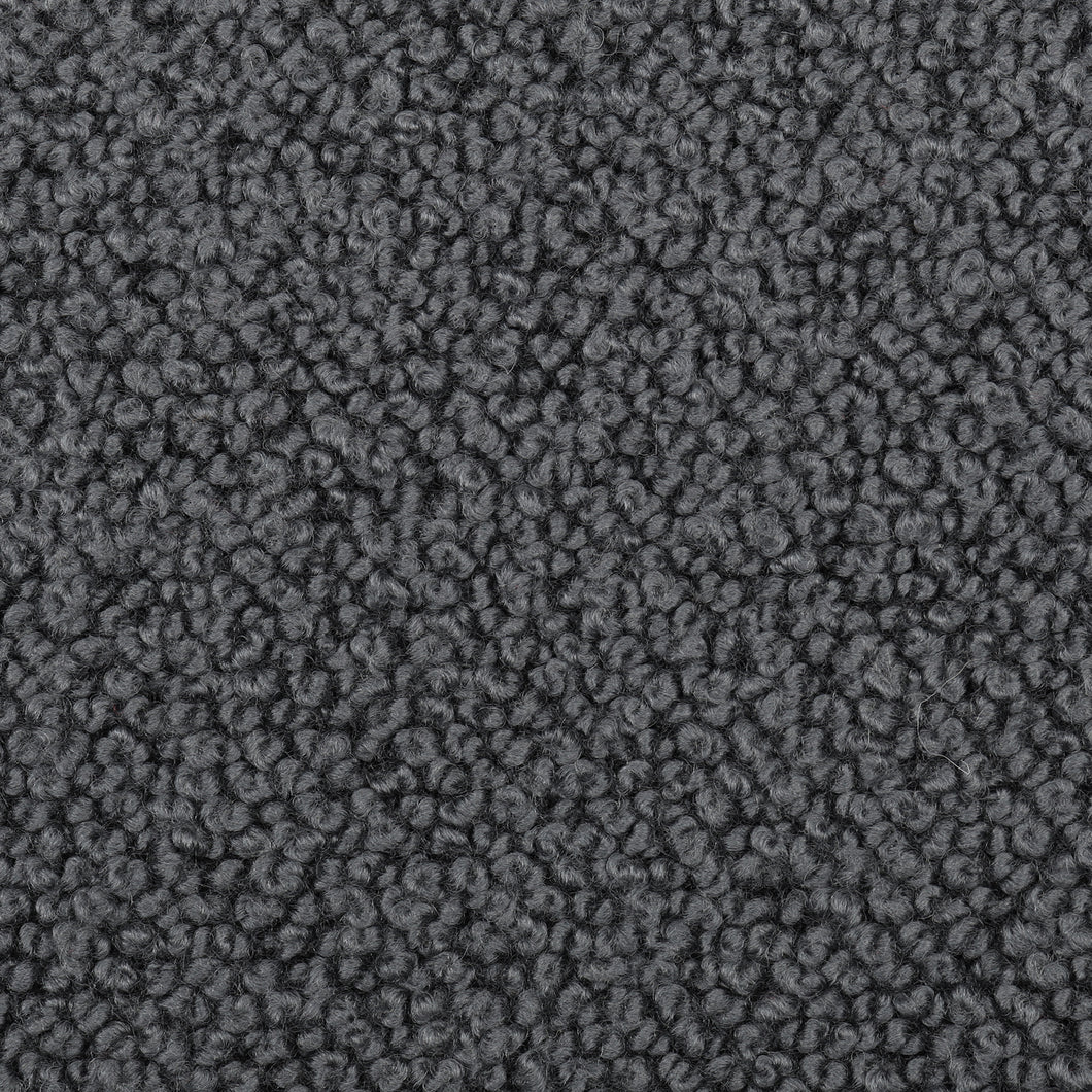 Storr is a large-scale chunky boucle fabric, suitable for both heavy duty and domestic upholstery applications.