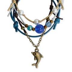 Closeup of Dolphin Charm on chain bracelet with glass beads
