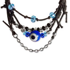 Close up of evil eye bead with black and blue beads