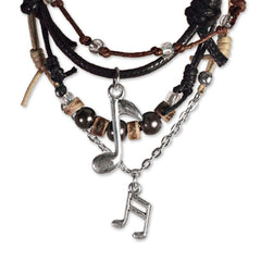Close up of Music Note Charms and beaded bracelet