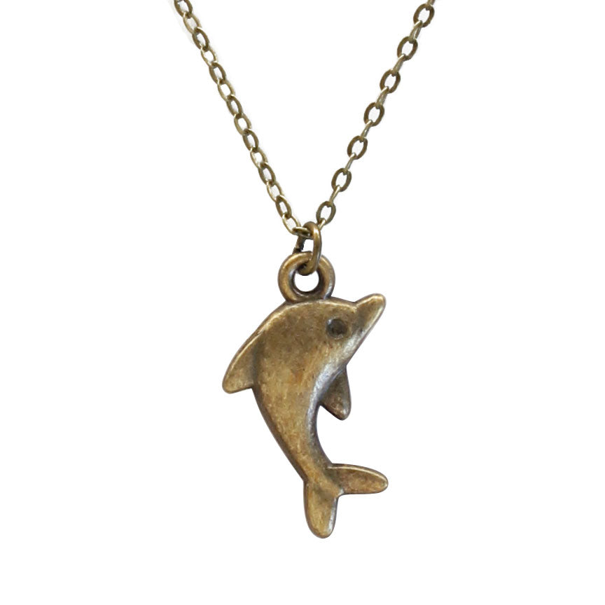 Close up of Bronze dolphin Charm