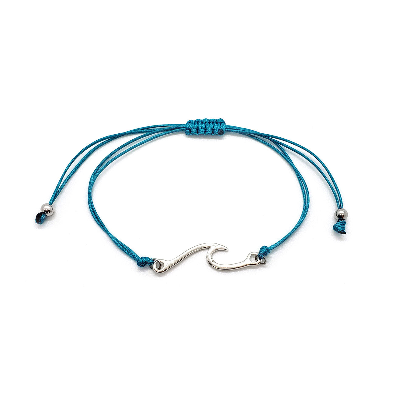 Wave Bracelet is a wave charm on aqua blue cord. Can be stacked or worn solo. Made by O Yeah Gifts!