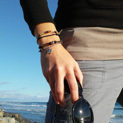 Girl at the beach wearing the Butterfly Charm Bracelet Set