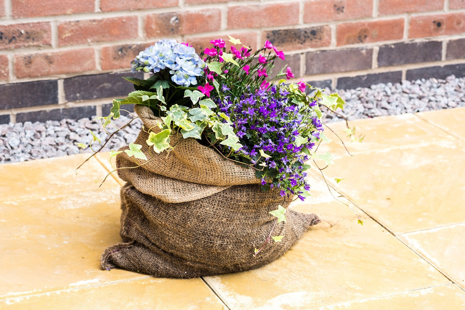 Lazy Flora hessian sack planter