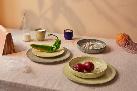 gradient ceramics with fresh fruit and vegetables on a table