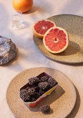 organically shaped plates with grapefruit and blackberries