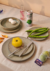 table setting with organic shaped plates and vegetables
