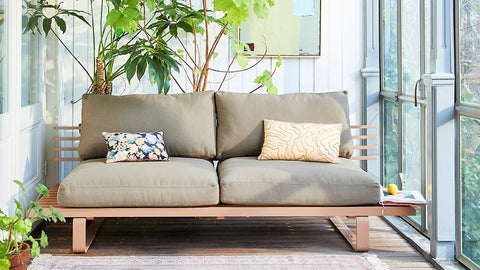 patio with outdoor sofa in peach color with grey seat cushions