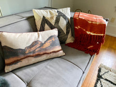 Hkliving pillows on couch in Woodstock way hotel