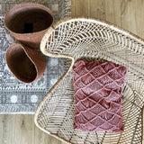 Egg chair made from rattan with a bohemian braid