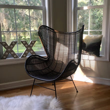 Black egg chair near window