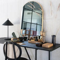 vanity with arch shaped mirror and willow wooden box